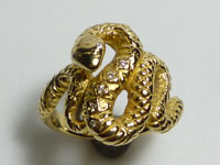 Ring of K18YG yellow gold snake and diamond coming repairing